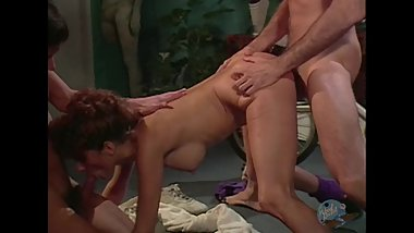 Group Sex with big titty redhead in gym