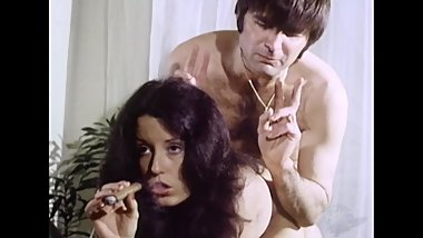 He bends her over and she smokes his cigar