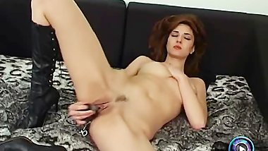 Bewitching brunette got a lot of sex toys to play with herself