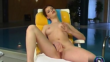 Katalin bravely gets naked to pet her kitty beside the pool