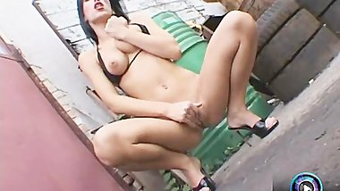 Exotic babe Mya Diamond pleasuring herself outside
