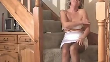 Classic MILF toying in the staircase