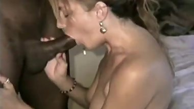 Teaching her a thing or two about sucking black cock